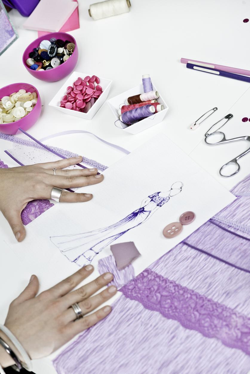 Fashion designer' creating new purple prom dress